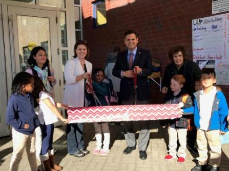 From left: Students participate in the ribbon cutting with Ward 5 School Committee Member Tara Murphy Beardsley (holding scissors), Mayor Gary Christenson and Malden Reads Member Linda Zalk.